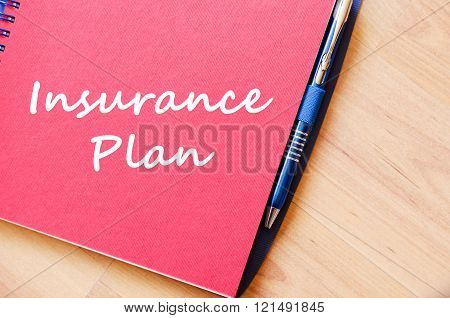 Insurance plan text concept write on notebook with pen