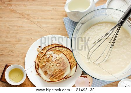 Prepared Pancakes For Breakfast. Ingredients For Making Pancakes, Dough And Fried Pancakes On A Wood