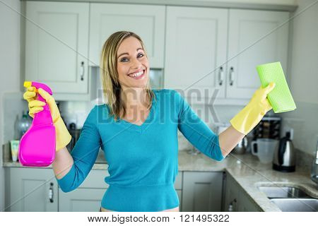 Pretty woman doing her house chores at home