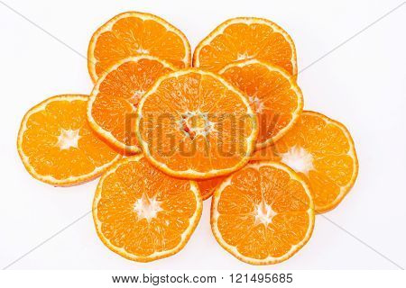 some slices of clementine fruit isolated on white background.