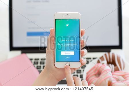 Woman Holding Iphone6S Rose Gold With Service Twitter On Screen