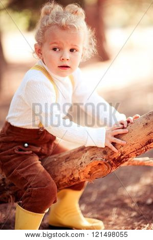 Funny girl sitting on tree