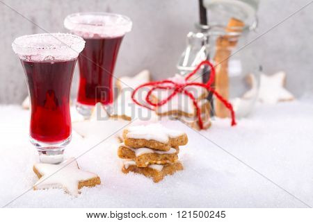 mulled wine glass with cinnamon stars in snow