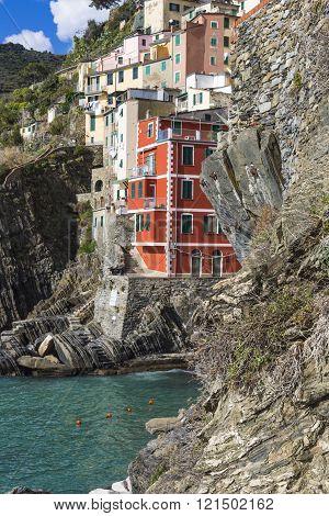 Riomaggiore Fisherman Village In A Dramatic Windy Weather. Riomaggiore Is One Of Five Famous Colorfu