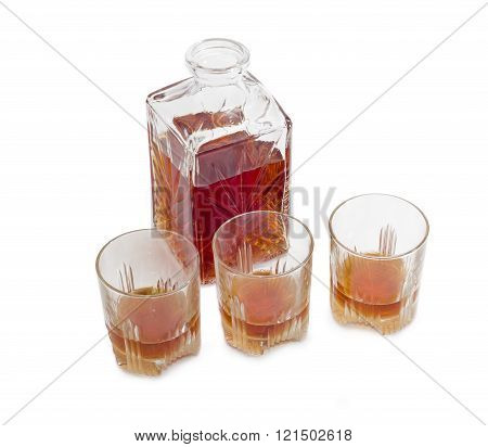 Decanter And Three Glasses With Whiskey On A Light Background