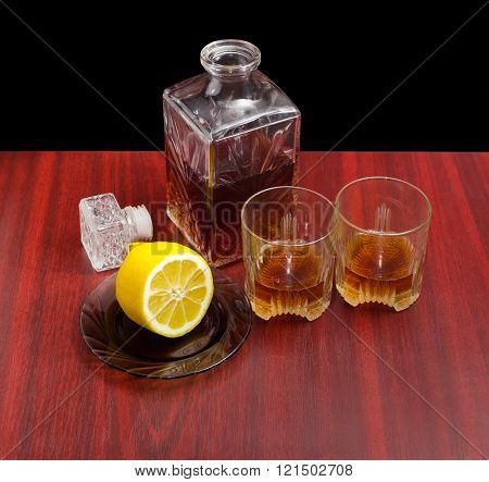 Decanter And Two Glasses With Whiskey, Lemon On A Saucer