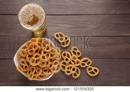 Glass Of Beer And Pretzel On The Wooden Background