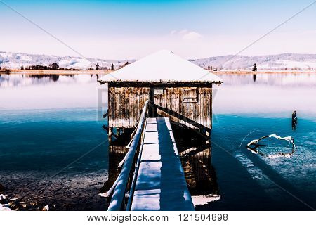 Boathouse winter lake fishing snow cabin bavaria