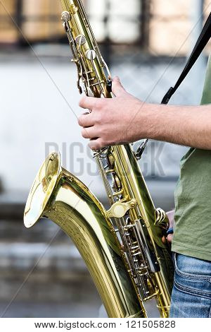 Street Performer Playing A Saxophone
