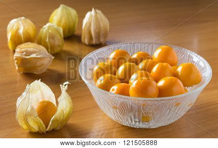 Orange Gooseberries In Bowl And On Tables