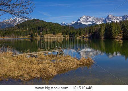 Idyllic Lake Geroldsee In Early Springtime, View To Karwendel Mountains