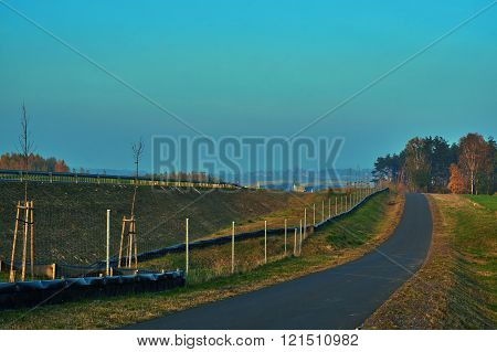 Rural landscape with a local road along the highway