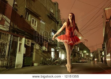 a young ballet dancer in a empty city street