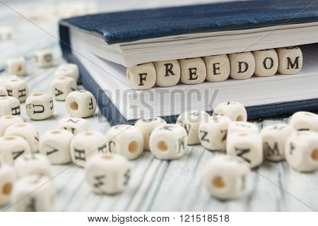 Wood Blocks with the word Feedom. Wooden ABC