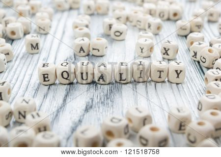 Equality word written on wood block. Wooden ABC
