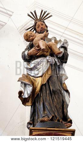 KOTARI, CROATIA - SEPTEMBER 16: Statue of Saint Joseph with baby Jesus on the Saint Anthony altar in the church of Saint Leonard of Noblac in Kotari, Croatia on September 16, 2015.