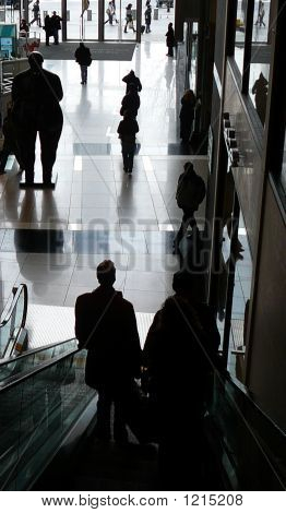 Silhouette Of Customers On Escalator Of Posh Public Mall At Columbus Circle In Manhattan