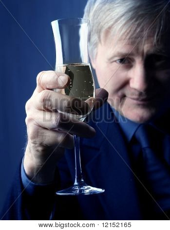 congratulation: senior man toasting with a glass of wine