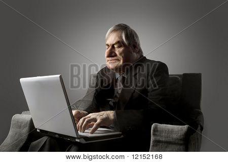 greedy businessman using laptop