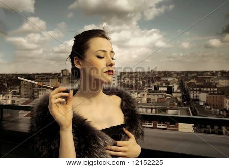 a rich woman with fur and cigarette on top of a building