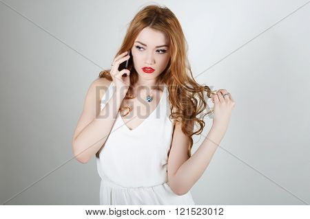 The Girl With Red Hair Talking On The Phone