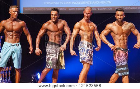 Male Fitness Models Show Their Physique In Swimsuit Om Stage