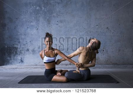 Couple practicing yoga together