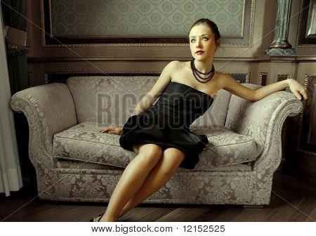 Beautiful woman sitting on a sofa