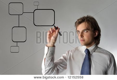 Business man drawing a digital graph