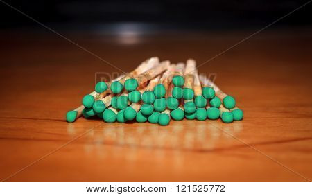 Matches With Green Head