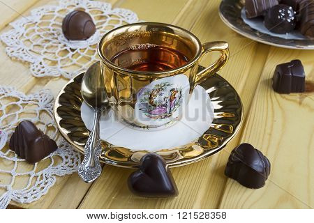 a cup of tea with chocolate candies