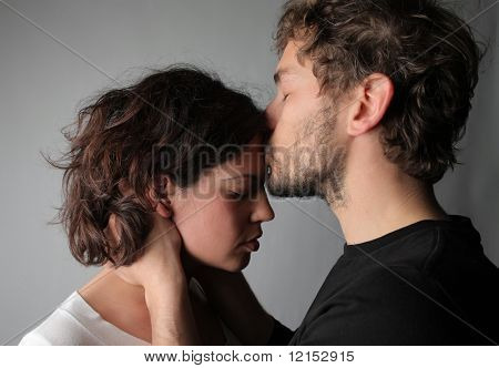 boyfriend comforts young female