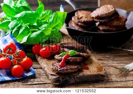 fritters from a liver with tomato sauce