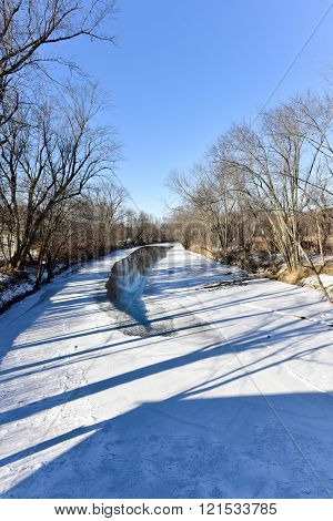 Snow covered Otter Creek River in Vermont from the Hammond Covered Bridge.