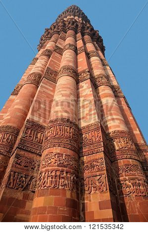 Qutub Minar red sandstone tower (minaret) at a world heritage site, Delhi, India
