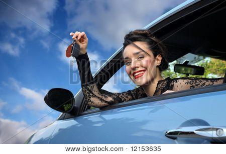 beautiful girl showing the key of car