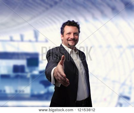 A businessman saying hallo in a modern office
