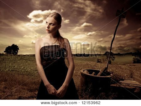 portrait of woman in black elegant dress in the country