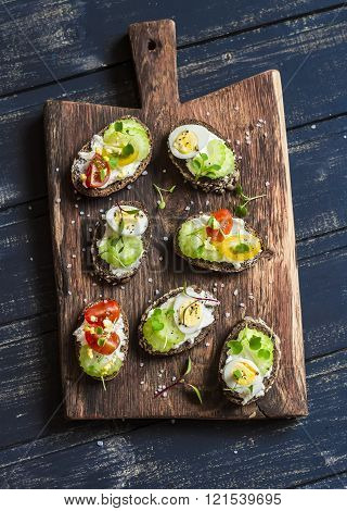 Sandwiches With Soft Cheese, Quail Eggs, Cherry Tomatoes And Celery. Delicious Healthy Snack Or Brea