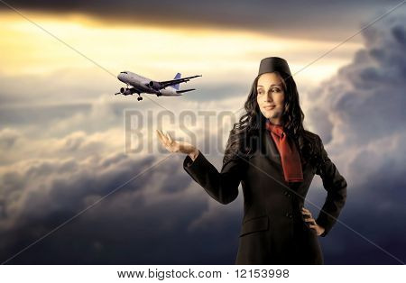 beautiful air hostess with flying airplane