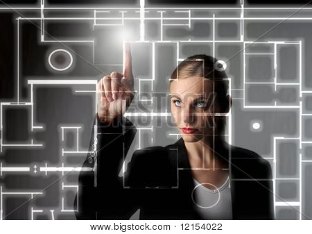 beautiful business woman drawing a digital blueprint