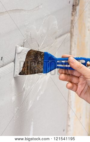 Hand Plastering A Wall With Spatula
