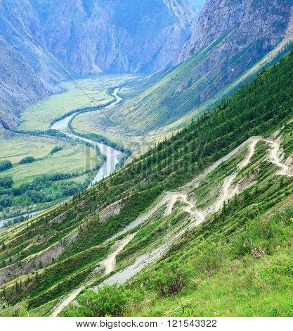 Serpentine road in the valley of the Altai Mountains in summer