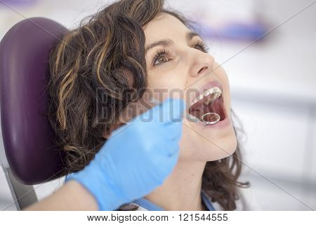 Beautiful Patient In The Dental Chair