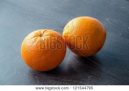 Two fresh juicy oranges for healty cooking.