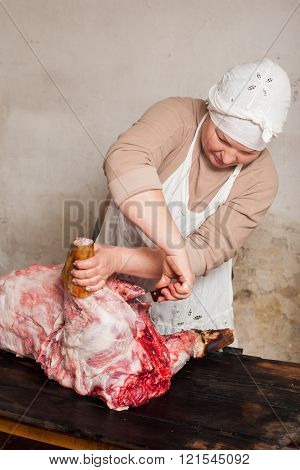 Butcher cutting raw pork in local market
