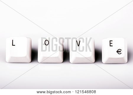 Word love formed with computer keyboard keys on white background with shadow