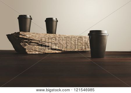 Two Paper Cups Unfocused One In Focus Isolated Wooden Table