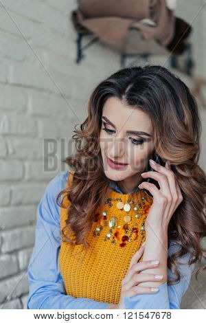 Charming lady speaking on the phone