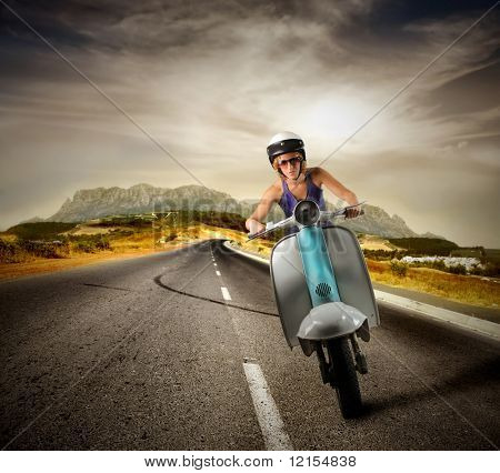girl riding a motorcycle on a country road